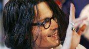 Johnny Depp popija rum