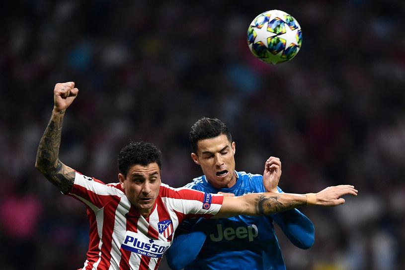 Jose Maria Gimenez (z lewej) i Cristiano Ronaldo /OSCAR DEL POZO /AFP