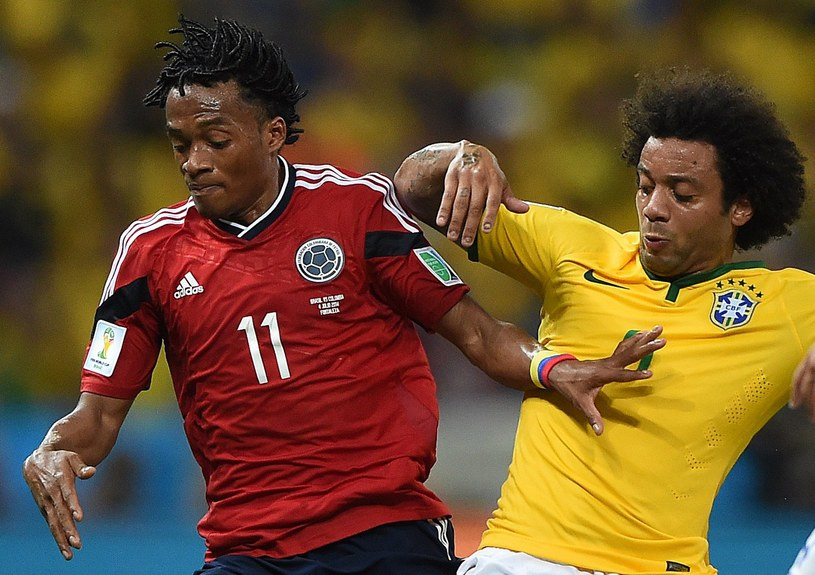 Juan Cuadrado i Marcelo /AFP