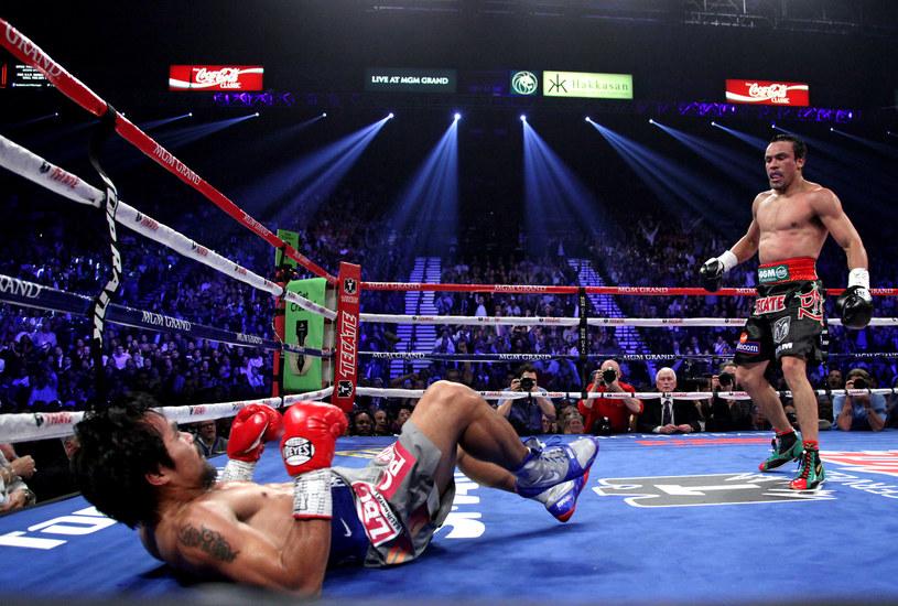 Juan Manuel Marquez (z prawej) w walce z Manny'm Pacquiao /AFP