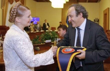 Julia Tymoszenko, premier Ukrainy wraz z Michelem Platinim, prezesem UEFA /AFP
