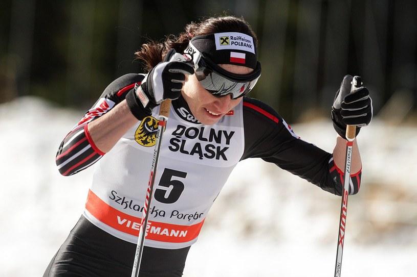 Justyna Kowalczyk podczas zawodów Pucharu Świata w Szkarskiej Porębie /AFP
