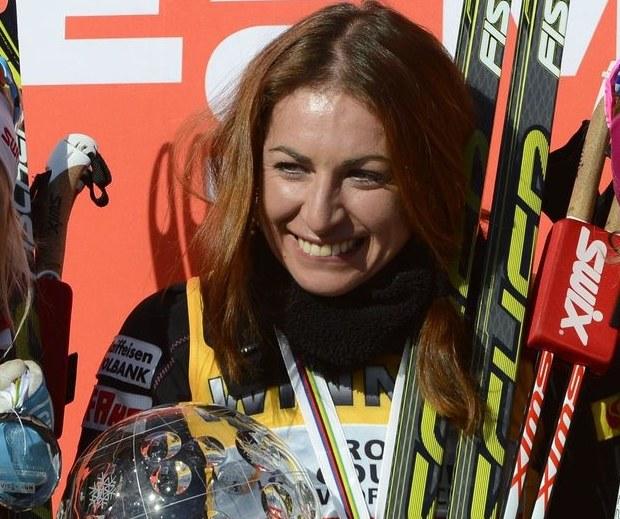 Justyna Kowalczyk z Kryształową Kulą za triumf w Pucharze Świata /AFP