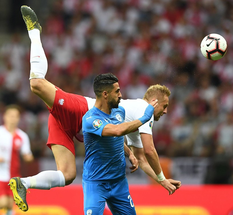 Kamil Glik podczas meczu reprezentacji Polski z Izraelem /AFP