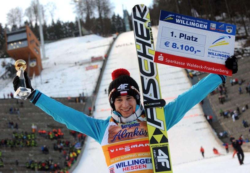 Kamil Stoch triumfuje w Willingen w 2014 roku /AFP
