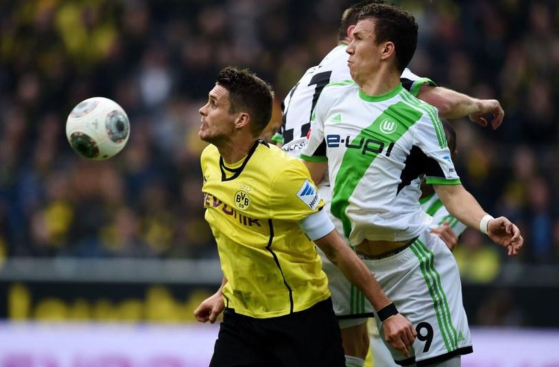 Kapitan Borussii Dortmund Sebastian Kehl (z lewej) /AFP