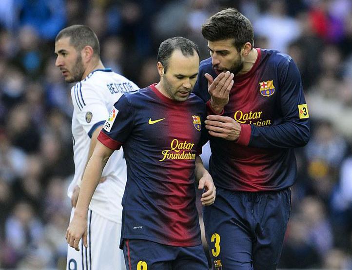 Karim Benzema, Andres Iniesta i Gerard Pique /AFP