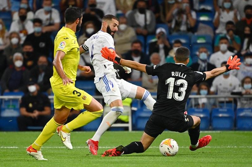 Karim Benzema w akcji /GABRIEL BOUYS /AFP