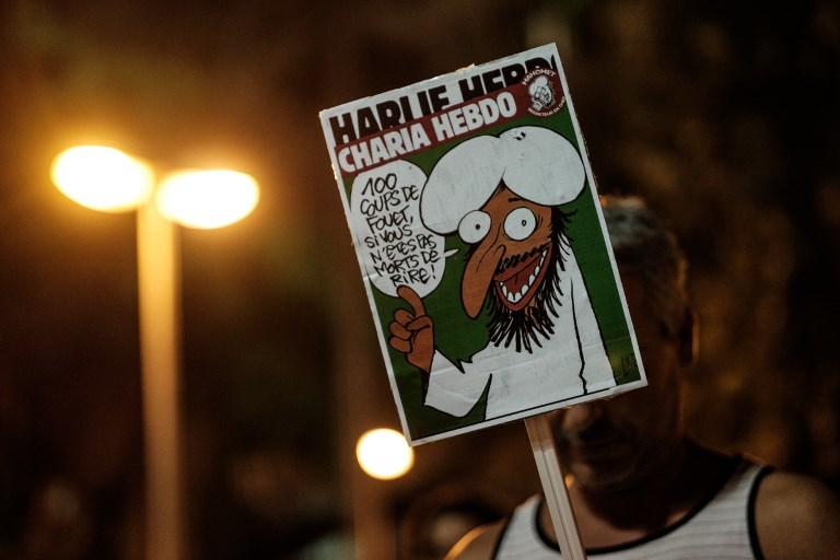 "Karykatura Mahometa na okładce ""Charlie Hebdo"" /YASUYOSHI CHIBA /AFP"