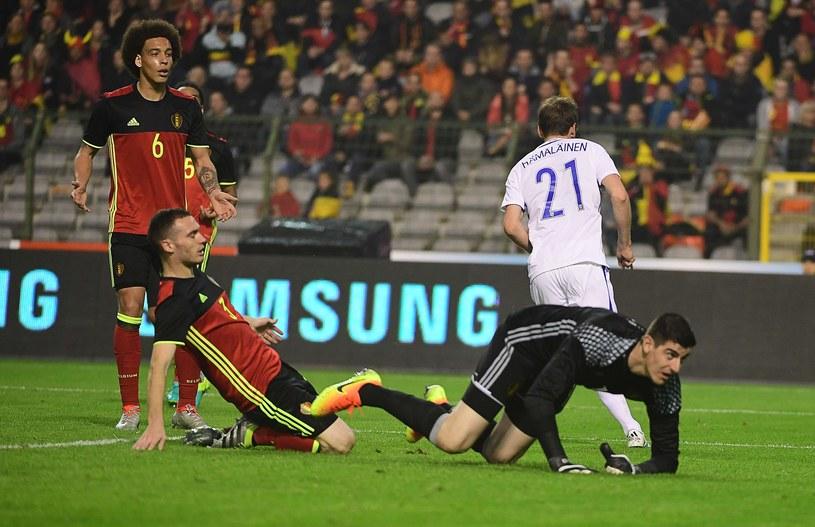 Kasper Hamalainen (w białym stroju) cieszy się z gola w meczu z Belgią /AFP