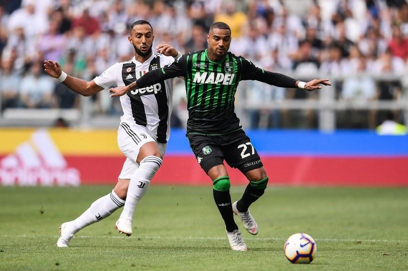Kevin-Prince Boateng (z prawej) podczas meczu z Juventusem /MARCO BERTORELLO /AFP
