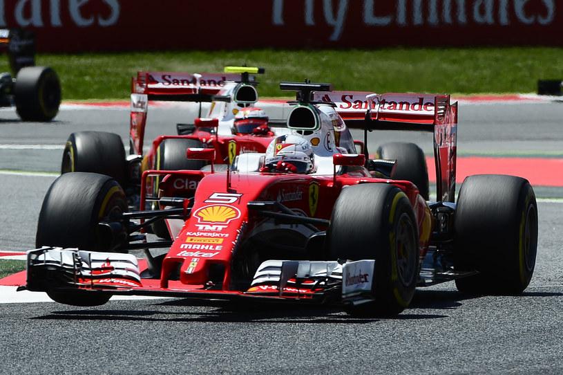 Kierowcy Ferrari:  Kimi Raikkonen i  Sebastian Vettel /AFP