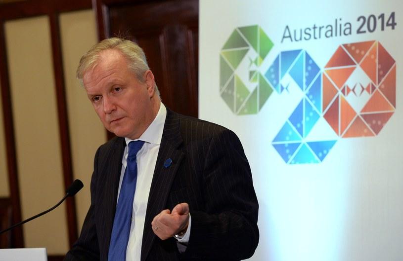 Komisarz UE ds. gospodarczych i walutowych Olli Rehn. /AFP