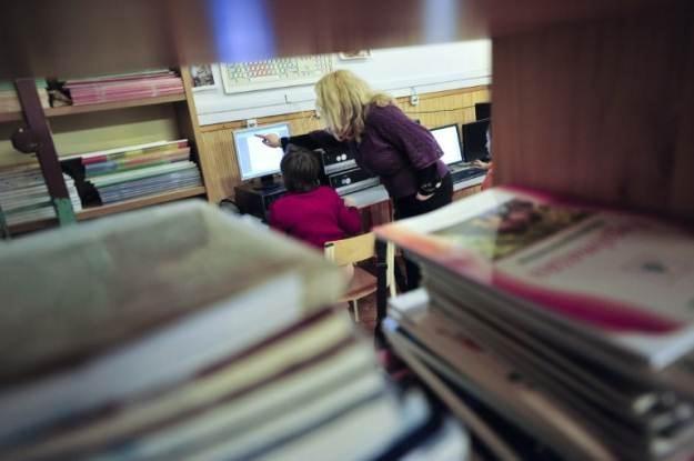 Komputery w szkole to już norma. Teraz przyszła pora na e-podręczniki? /AFP