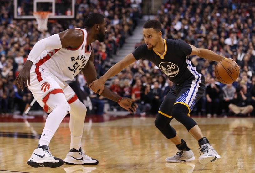Koszykarz Golden State Warriors Stephen Curry (z piłką) /AFP