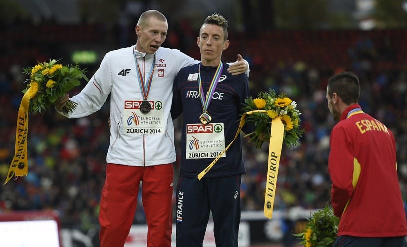 Krystian Zalewski, Yoann Kowal (obaj na podium), z boku Angel Muller /AFP