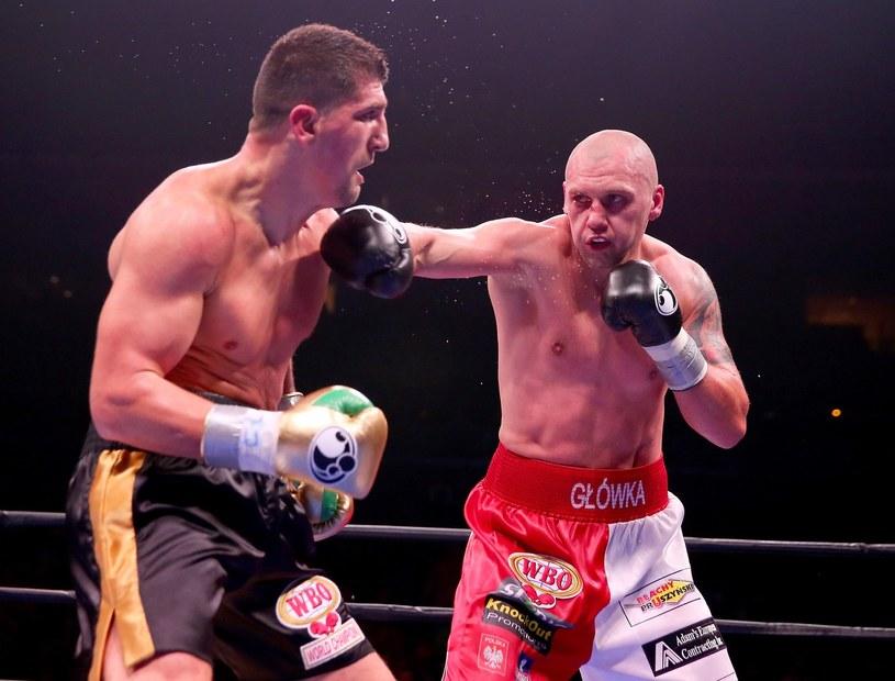 Krzysztof Głowacki (z prawej) w pojedynku z Marco Huckiem /AFP