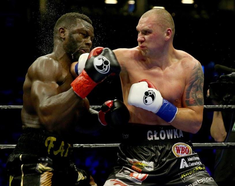 Krzysztof Głowacki (z prawej) w pojedynku ze Stevem Cunninghamem /AFP