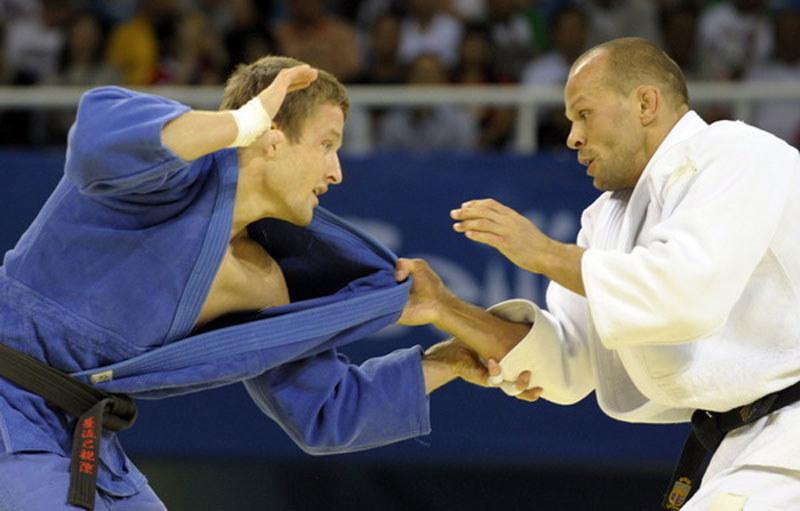 Krzysztof Wiłkomirski (z lewej) podczas igrzysk w Pekinie /AFP