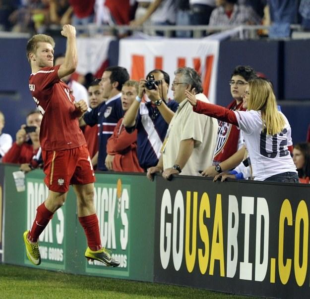 Kuba Błaszczykowski cieszy się z gola na 2-2 /AFP
