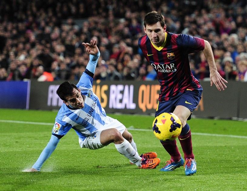 Leo Messi w akcji w meczu z Malagą /AFP