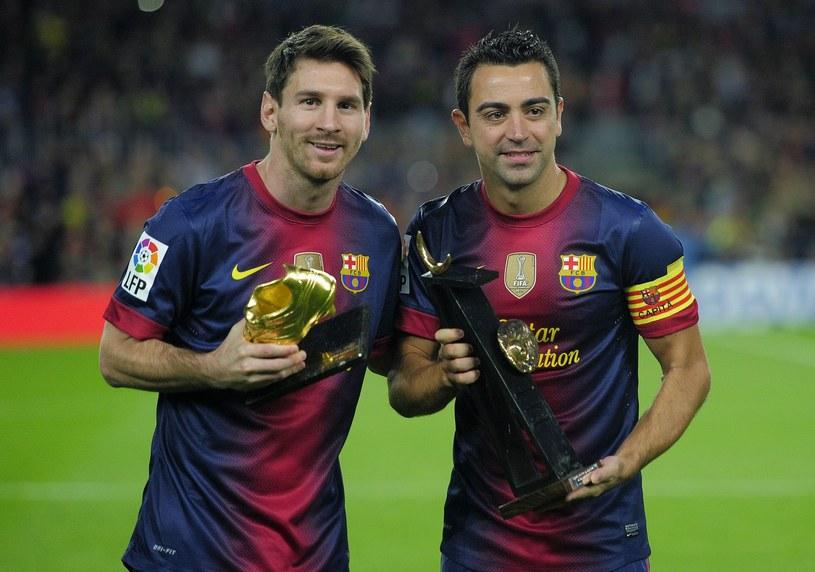 Leo Messi (z lewej) i Xavi Hernandez /AFP