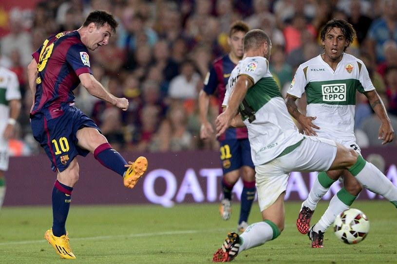 Lionel Messi strzela pierwszego gola dla Barcelony /AFP