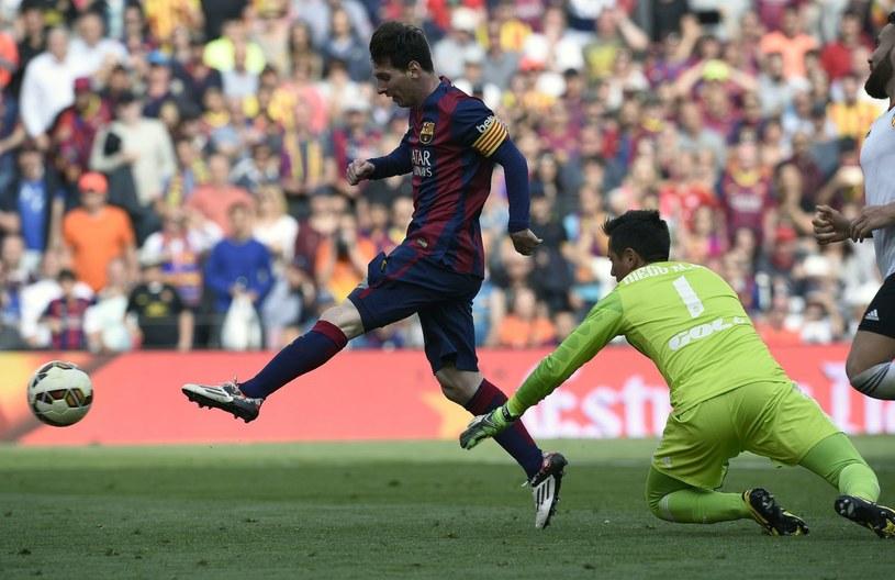 Lionel Messi (z lewej) /AFP