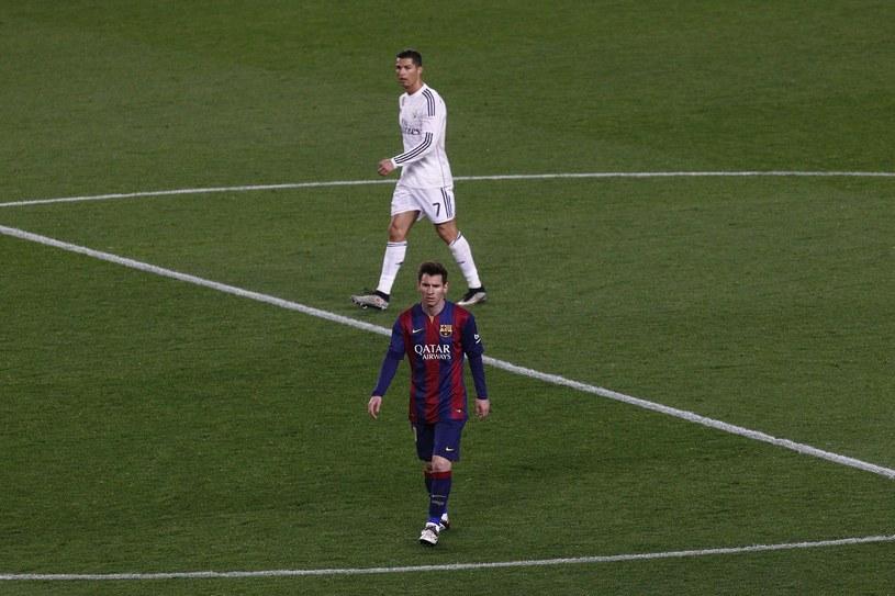 Lionel Messi (z przodu) i Cristiano Ronaldo /AFP
