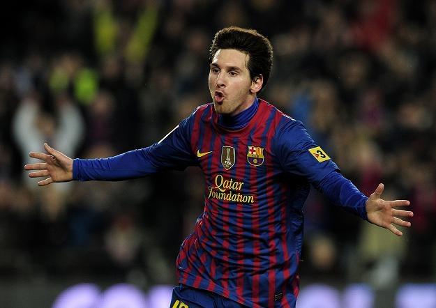 Lionel Messi  zdobył trzy gole w meczu Barcelony z Valencią. /AFP