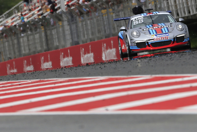 Loeb w Porsche /AFP