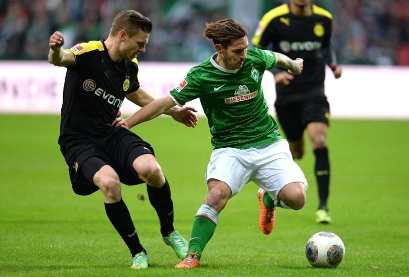 Ludovic Obraniak (zielony strój) może zmienić klub /AFP