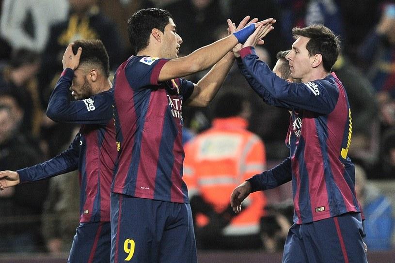 Luis Suarez i Lionel Messi potrafią zatańczyć z rywalami. /AFP