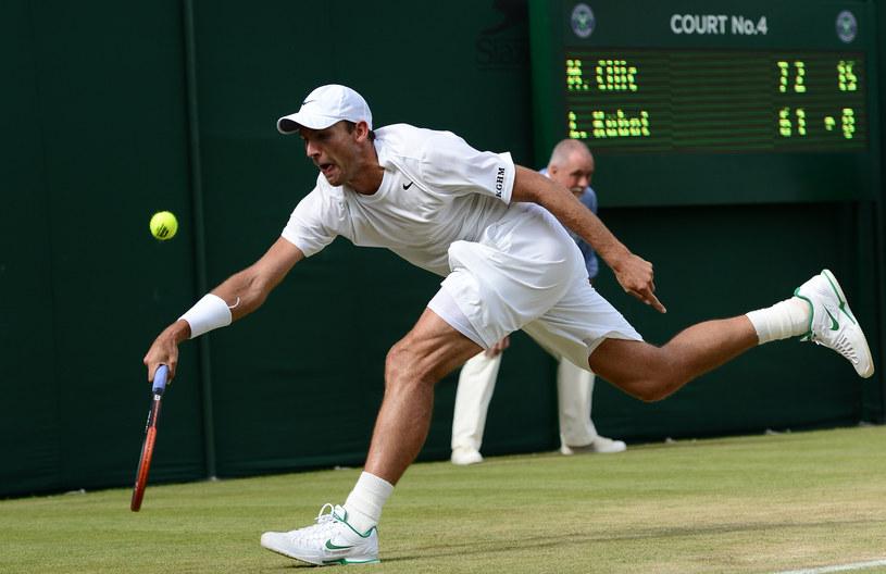 Łukasz Kubot już pożegnał się z Wimbledonem. /. /AFP