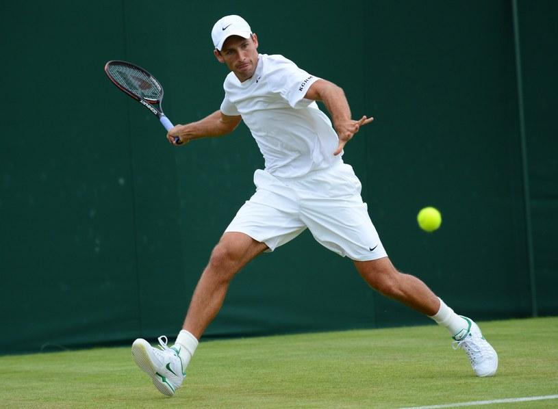 Łukasz Kubot na trawiastych kortach Wimbledonu /. /AFP