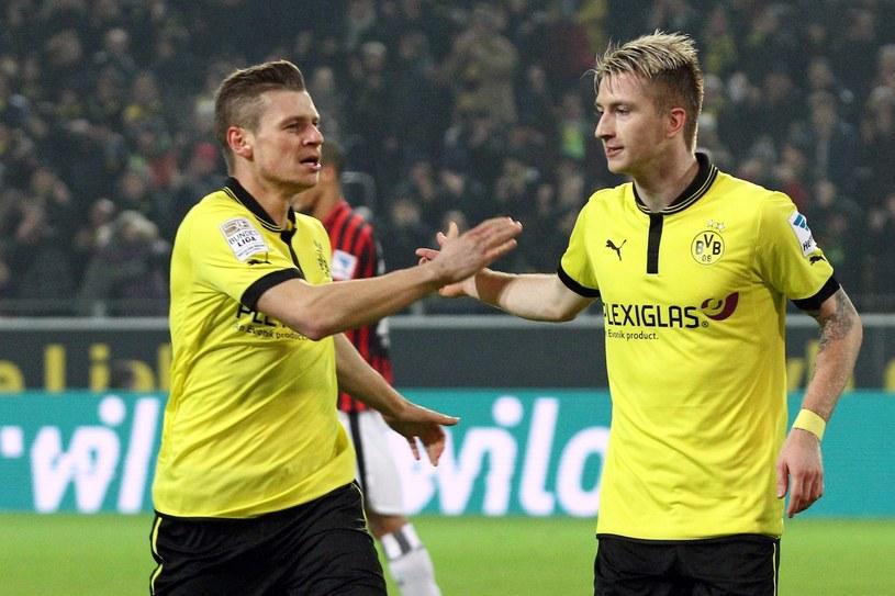 Łukasz Piszczek i Marco Reus podczas meczu z Eintrachtem /AFP