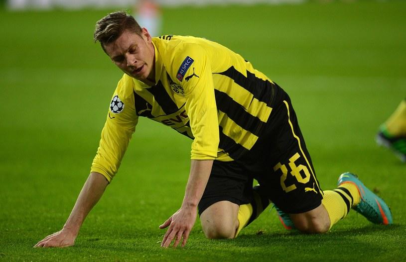 Łukasz Piszczek ma ostatnio ciężki okres, ale wytrzymuje obciążenia meczowe. /AFP
