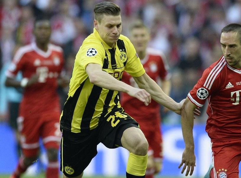 Łukasz Piszczek podczas meczu Borussii z Bayernem Monachium w finale Ligi Mistrzów /AFP