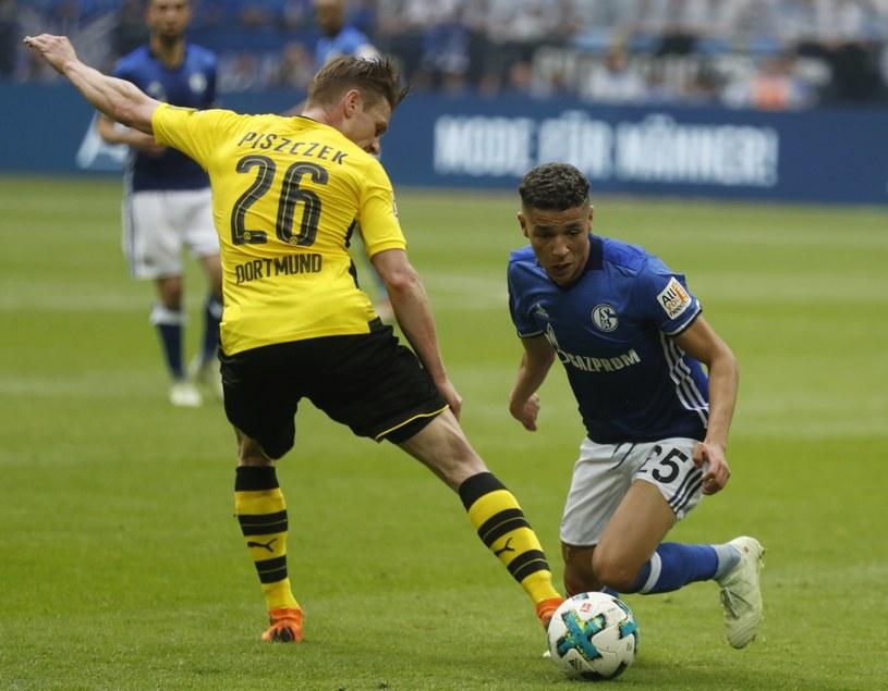 Łukasz Piszczek w meczu z Schalke 04 Gelsenkirchen /PAP/EPA