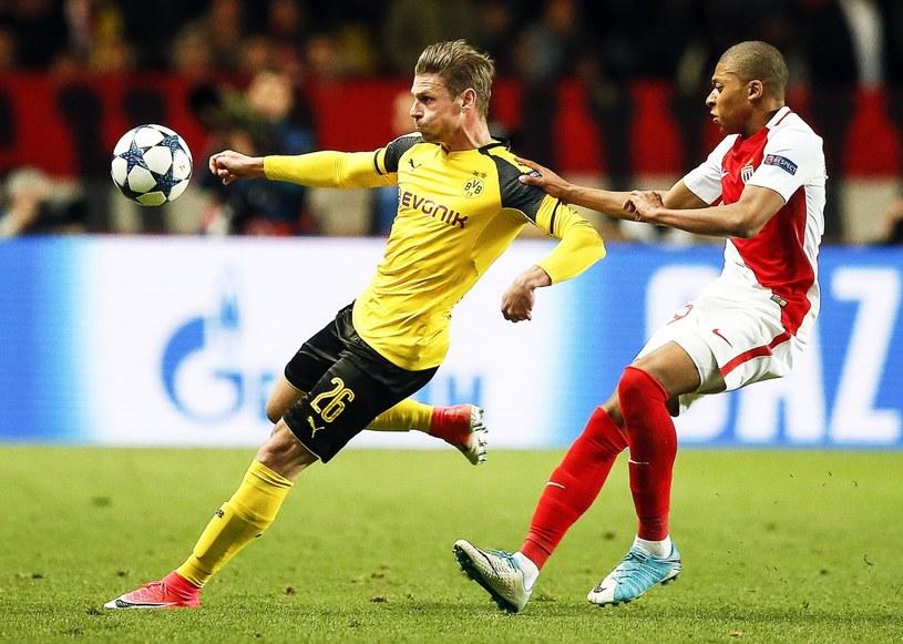 Łukasz Piszczek (z lewej) w meczu z AS Monaco /PAP/EPA