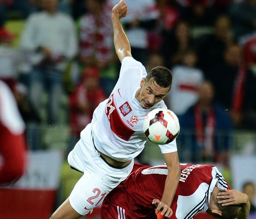 Łukasz Szukała zadebiutował w reprezentacji w towarzyskim meczu z Danią /AFP