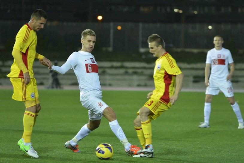 Łukasz Teodorczyk (w środku) w meczu reprezentacji Polski /AFP