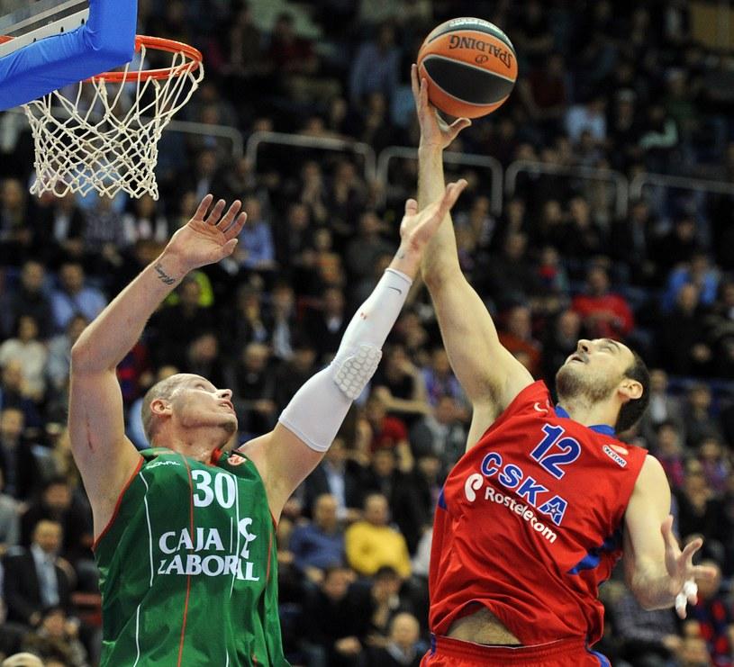 Maciej Lampe i Nenad Krstic /AFP