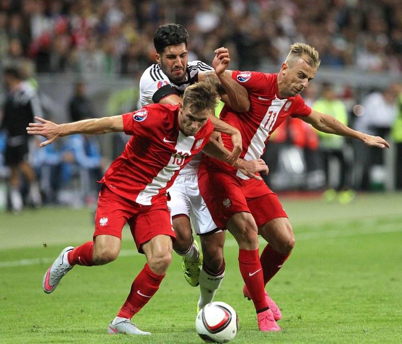 Maciej Rybus (na pierwszym planie) w barwach reprezentacji Polski /AFP