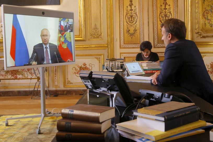 Macron i Putin rozmawiali m.in. o sytuacji w Libii i na Ukrainie /MICHEL EULER / POOL /PAP/EPA