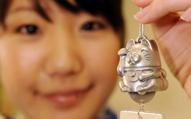 """Maneki Neko - zdjęcie """"zapraszającego kota"""" /AFP"""