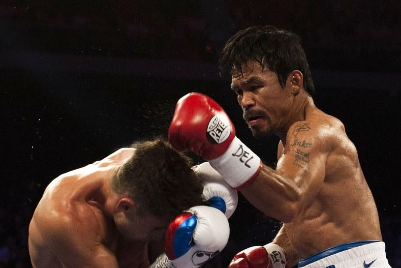Manny Pacquiao w akcji podczas walki z Chrisem Algierim /AFP