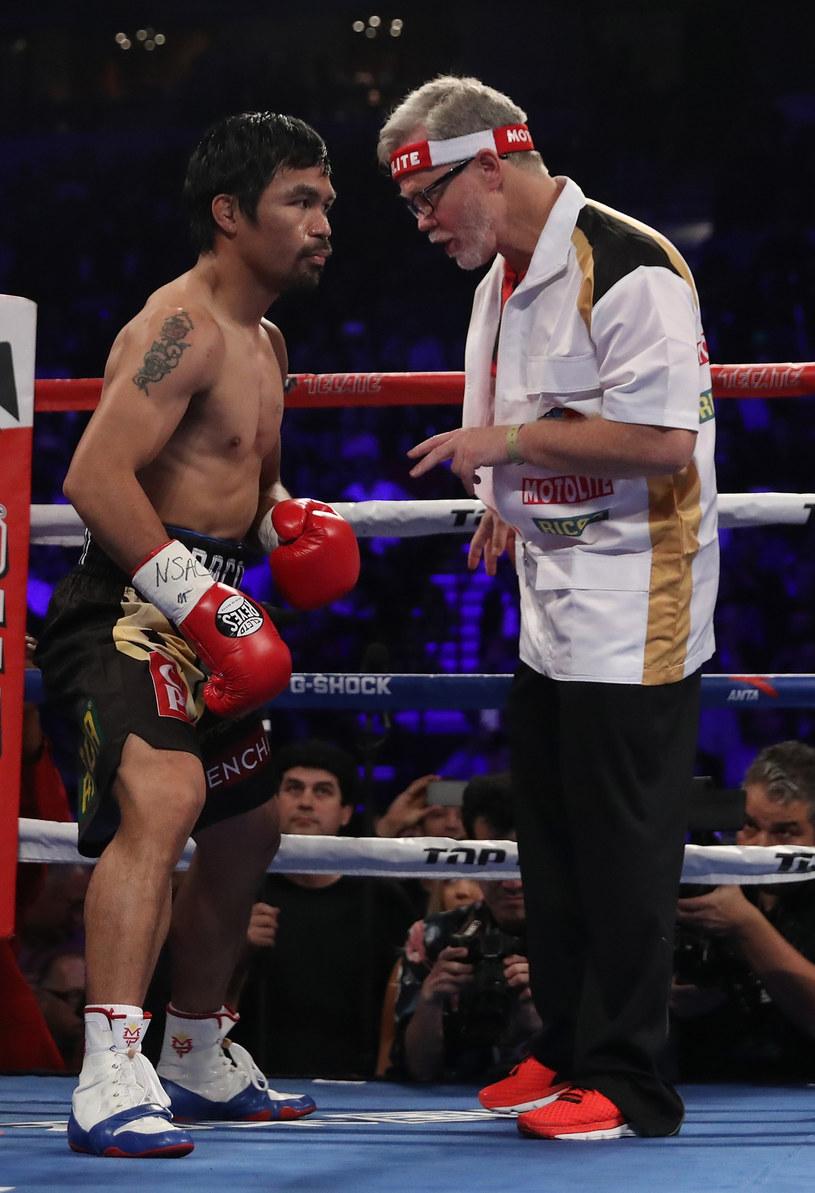 Manny Pacquiao (z lewej) i Freddie Roach /AFP