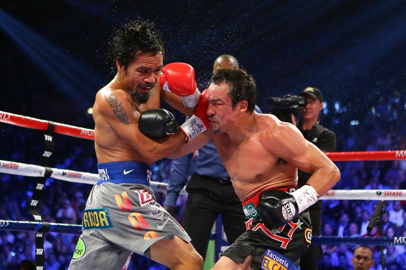 Manny Pacquiao (z lewej) kontra Juan Manuel Marquez /AFP