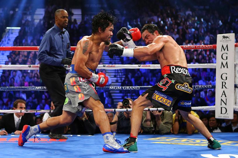 Manny Pacquiao (z lewej) w walce z Juanem Manuelem Marquezem /AFP